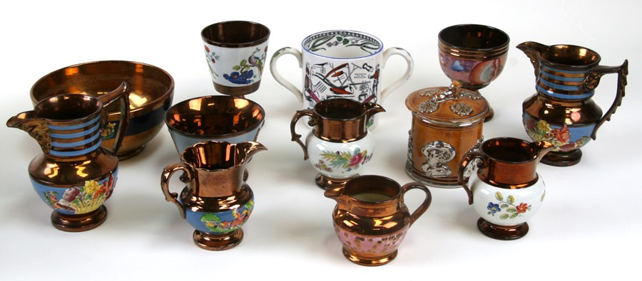 A quantity of copper lustre ware to include jugs, bowls and goblets.