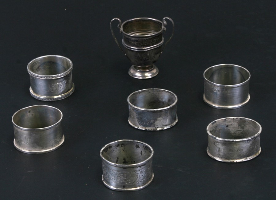 Six silver napkin rings, various dates and makers, all initialled; together with a small silver