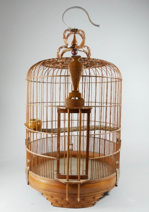 Two Chinese carved wooden birdcages. 50cm 19.75 ins) high