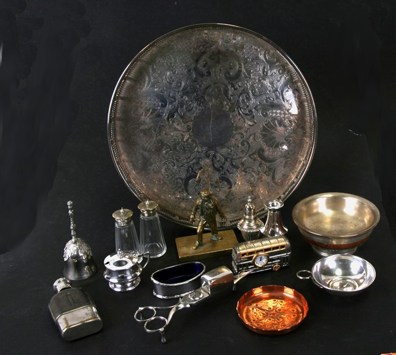 A circular silver plated galleried tray; together with a silver plated wine taster; a Tibetan bowl