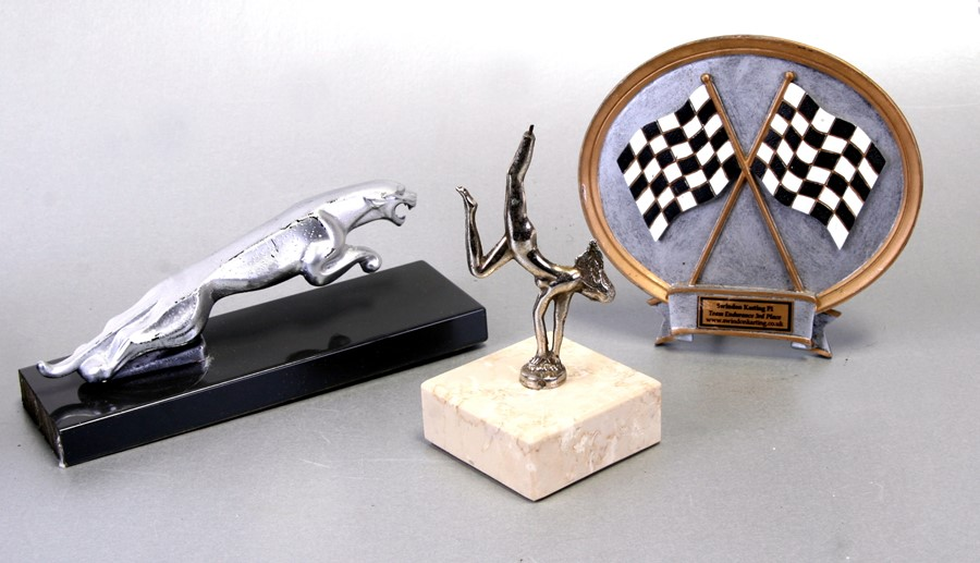 A leaping jaguar car mascot mounted on a plinth, 20cms (8ins) long, an accessory car mascot in the