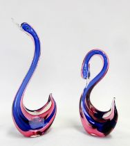 A Murano Sommerso glass swan, 16cms (4ins) high; together with another, 30cms (12ins) high (2).