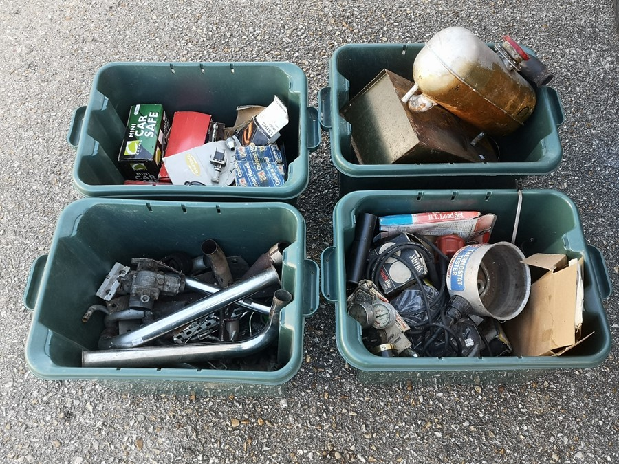 A large quantity of car spares including jubilee clamps, exhaust components, air filters, petrol