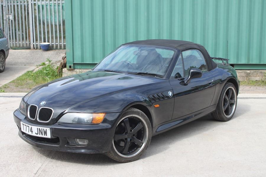 A 1999 BMW Z3 1.8 Roadster, registration number T774 JNW, black. Finished in black with a black