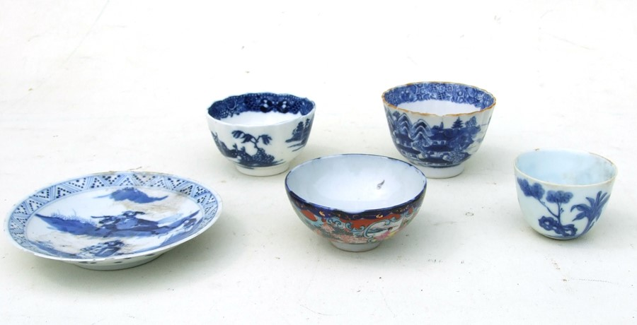 A Chinese blue & white tea bowl decorated with an erotic scene with four character blue mark to