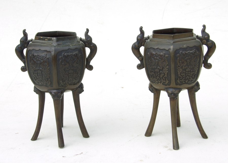 A pair of Japanese bronze censers on four elongated lion mask capped legs, 14cms (5.5ins) high (2).