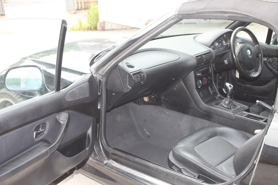 A 1999 BMW Z3 1.8 Roadster, registration number T774 JNW, black. Finished in black with a black - Image 7 of 10