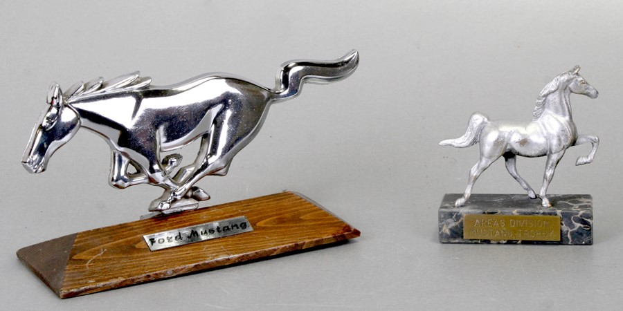 A Ford Mustang insignia mounted on a plinth, 20cms (8ins) wide and an Area's Division Mustang trophy