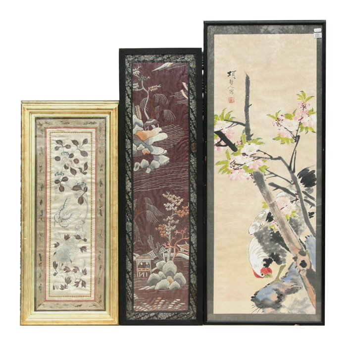 A Chinese silk embroidered panel depicting a butterfly amongst flowering foliage, 24 by 64cms (9.5