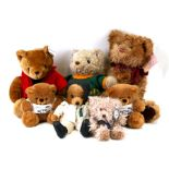 A Harrods plush teddy bear, approx 34cms (13.5ins) high; together with other teddy bears with a