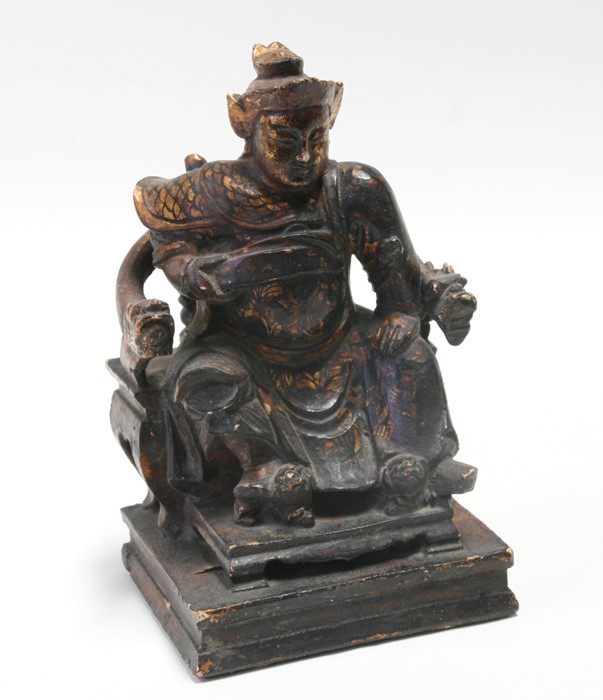 A Chinese gilded lacquer wooden figure depicting a General seated in a throne chair, 27cms (10.5ins)