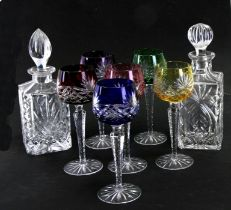 A set of six Bohemian flashed glass hock glasses; together with a pair of decanters (8).Condition