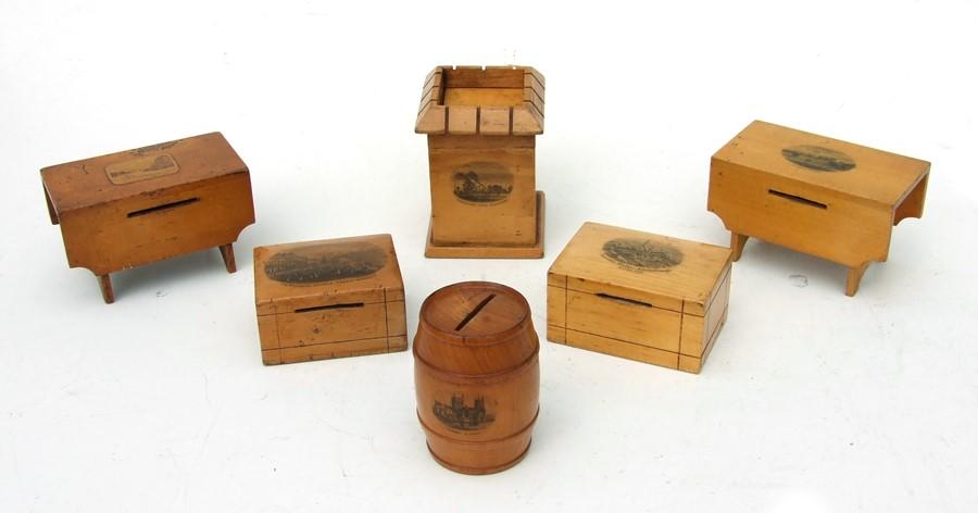 A collection of Victorian Mauchline ware money boxes to include a tower form example.