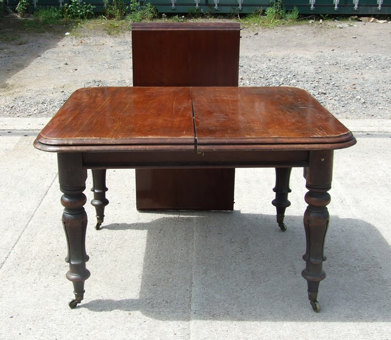 A 19th century mahogany extending dining table with one extra leaf, 118 by 104cms (46.5 by 41ins).