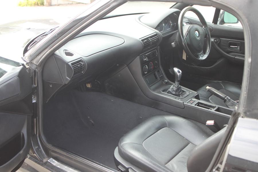 A 1999 BMW Z3 1.8 Roadster, registration number T774 JNW, black. Finished in black with a black - Image 8 of 10
