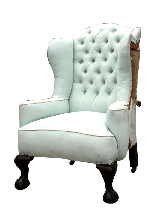 A 18th century style wing armchair, partially re-upholstered.