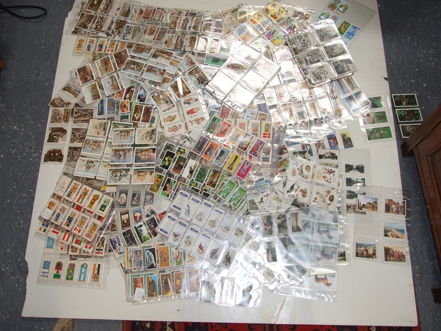 A large quantity of assorted cigarette and trade cards covering all subjects including Disney., - Image 3 of 5