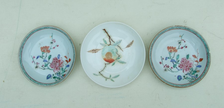 A pair of 18th century Chinese shallow dishes decorated with flowers, 14cms (5.5ins) diameter;