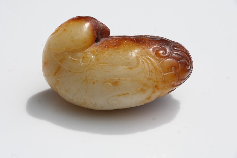 A Chinese russet jade figure of a quail mounted on a hardwood stand, 5.5cms (2.25ins) long. - Image 3 of 9