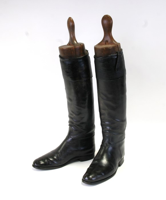 A pair of black leather riding boots with wooden trees.Condition ReportSole measures 29cms and the