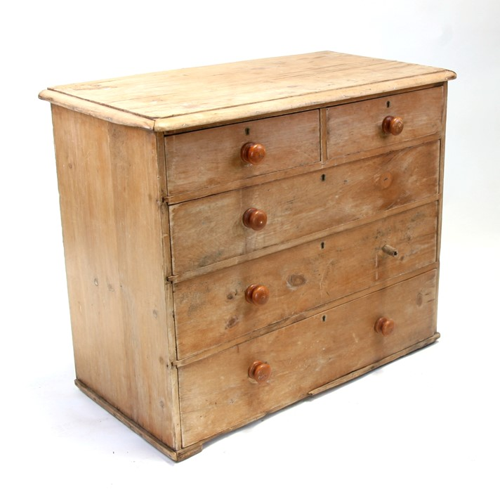 A Victorian stripped pine chest of two short and three graduated long drawers, 103cms (40.5ins)