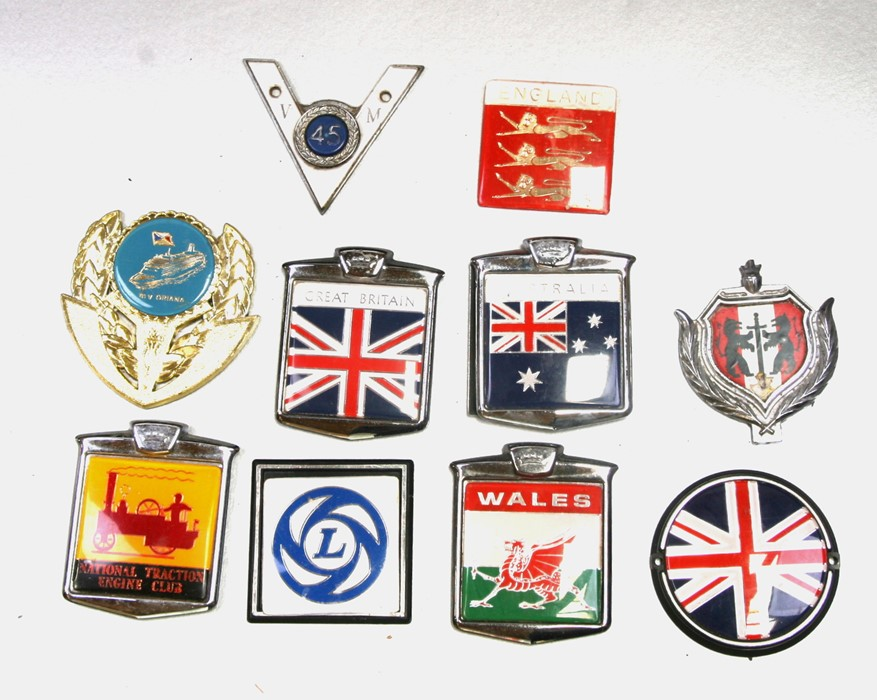 Assorted badge bar badges including British Leyland, National Traction Engine Club and others.