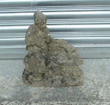 A well weathered reconstituted stone garden figure, 31cms (12.25ins) wide.