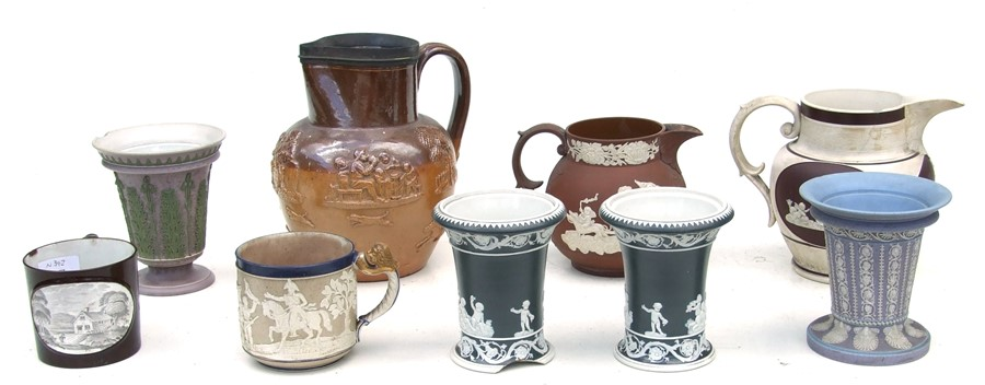 A 19th century stoneware commemorative mug depicting Wellington; together with two Jasperware