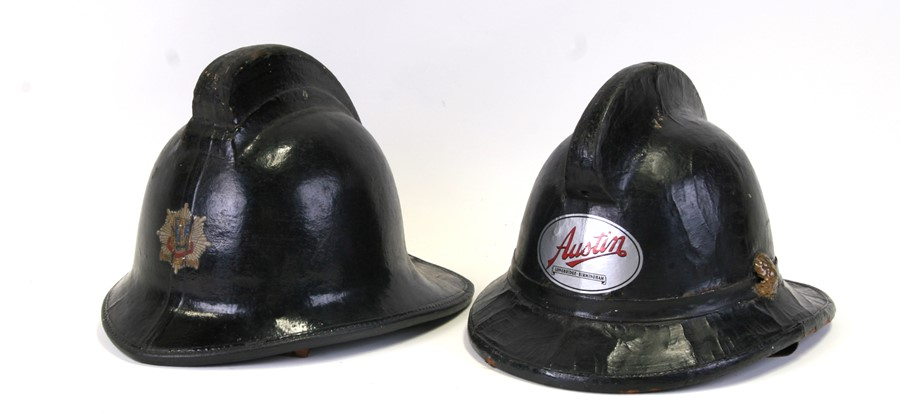 An original black leather, cloth and cork fireman's helmet with Shropshire Fire Brigade insignia and