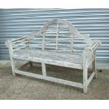 A well weathered teak Lutyen style garden bench, 170cms (67ins) wide.