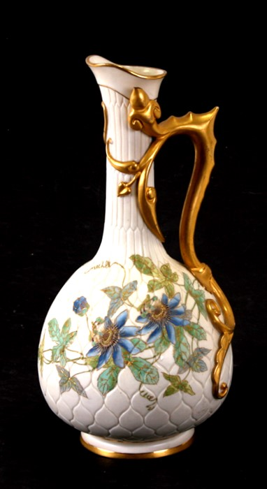 A Royal Worcester Aesthetics period ewer with tube lined decoration in the form of passionflowers,