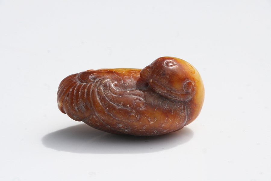 A Chinese russet jade figure of a quail mounted on a hardwood stand, 5.5cms (2.25ins) long. - Image 6 of 9