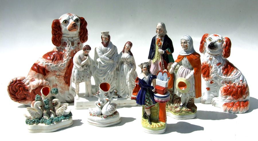 A group of Staffordshire pottery figures to include spaniels and spill vases, the largest 31cms (