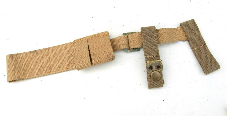 An unissued 08 Pattern bayonet frog with helve strap and carrier. Marked to the reverse of the