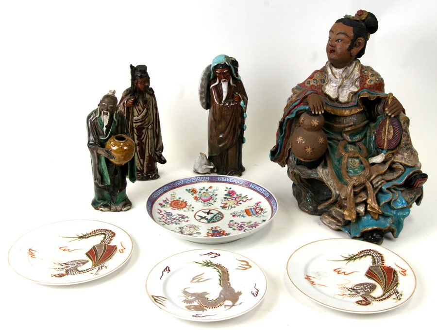 A large Chinese polychrome pottery figure depicting a seated official, 33cms (13ins) high;