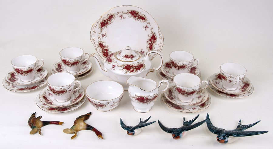 A set of three Beswick graduated swallow wall plaques; together with a Paragon Majestic pattern