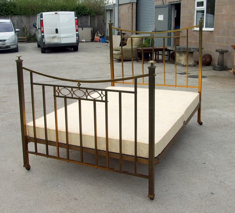 A brass double bed.Condition ReportGood clean condition and measures 4'6 by 6'3ins.
