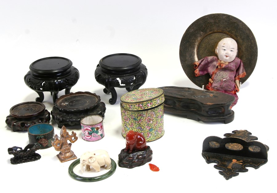 A group of Chinese hardwood and lacquer vase stands; together with a Chinese doll and other items.