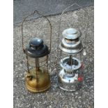 An Anchor chrome bodied Tilly lamp and another Tilly lamp (2).