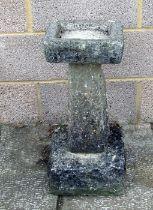A three-section stone birdbath, 61cms (24ins) high.