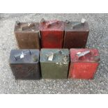 Six 1930's two-gallon petrol cans to include Esso, Pratts and BP, all with brass caps (6).