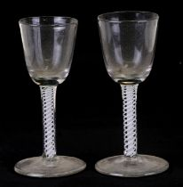 A near pair of 18th century wine glasses with air twist stems, 13cms (5ins) high (2).Condition