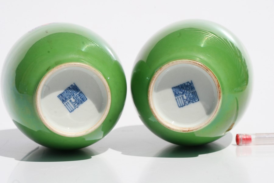 A pair of Chinese green monochrome vases with blue seal mark to the underside, 16cms (6.25ins) - Image 2 of 6