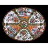 A 19th century Chinese famille rose oval meat plate decorated with figures, flowers, butterflies and
