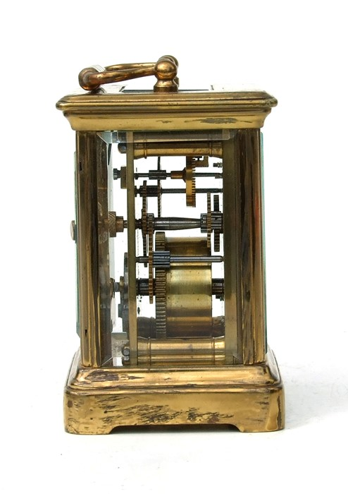 A miniature four-pillar gilt brass carriage clock, the white enamel dial with Roman numerals, - Image 2 of 3