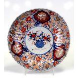 A Japanese Imari ribbed shallow bowl with wavy rim, 31cms (12.25ins) diameter.