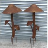 A pair of metal garden mushroom groups, 74cms (29ins) high (2).Condition Reportrusty and weather