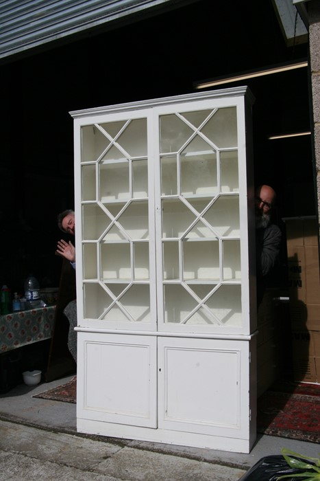 A pair of painted pine bookcases on cupboards, the pair of glazed doors enclosing a shelved interior - Image 2 of 11