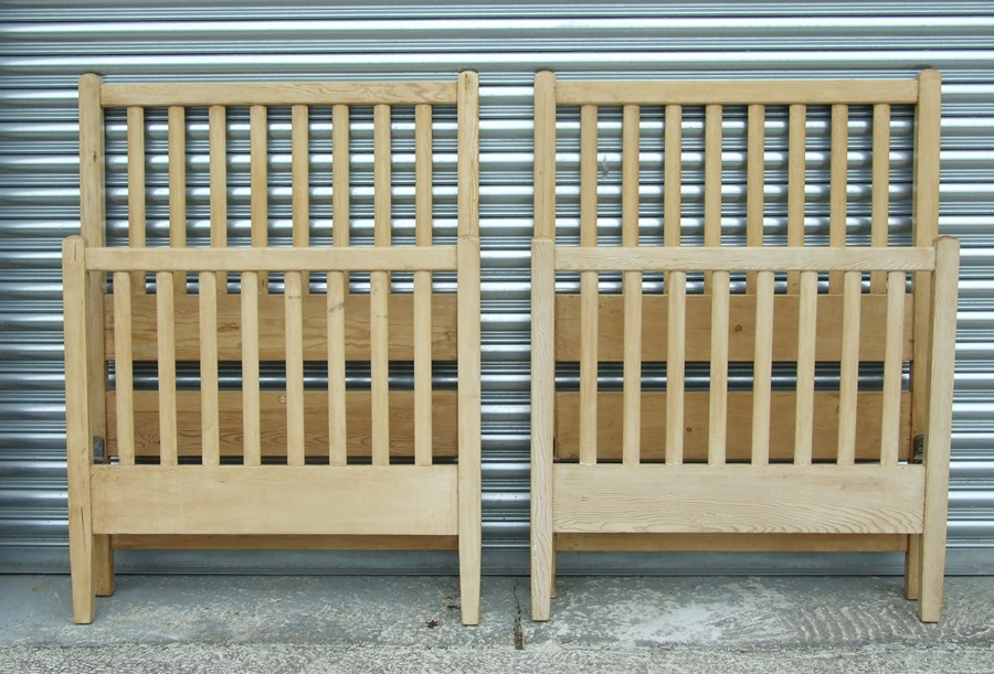 A pair of Heal's stripped pine single bed ends, 92cms (36ins) wide.