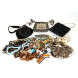 A quantity of costume jewellery together with three ladies evening bags